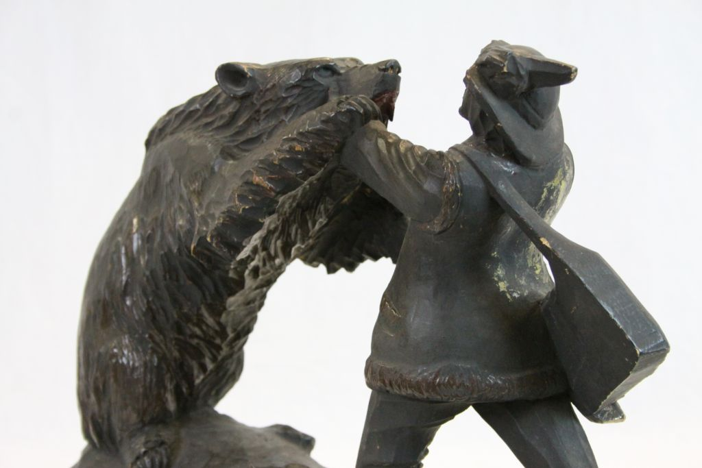 Lot 53 - Large Black Forest Carved Model of a Bear fighting a Hunter Man, 37cms long