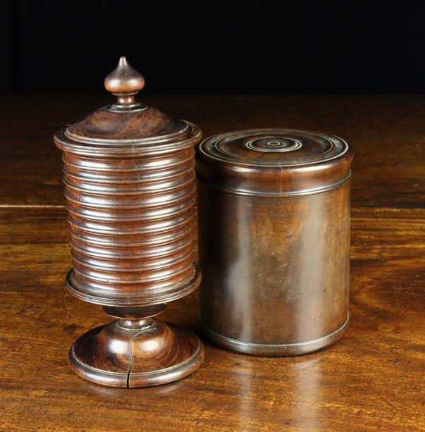 Lot 23 - Two 19th Century Turned Rosewood Lidded Jars: An early pedestal footed container with fine reel