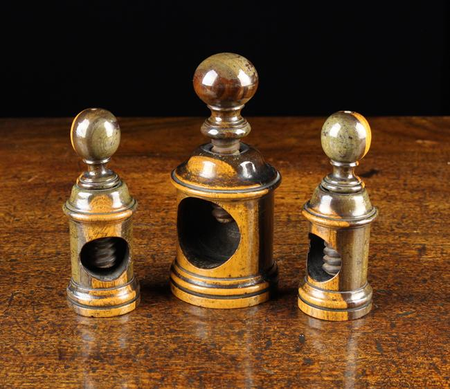 Lot 15 - Three 19th Century Turned Lignum Vitae Nut Crackers with screw thread crackers surmounted by ball