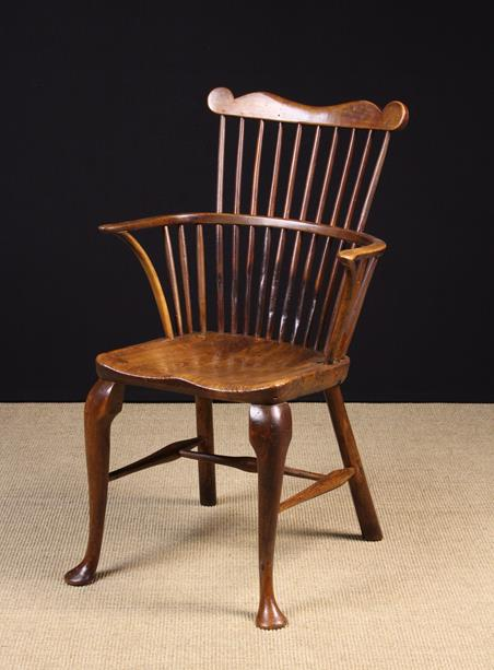 Lot 54 - A Small Comb Backed Windsor Armchair on Cabriole legs.