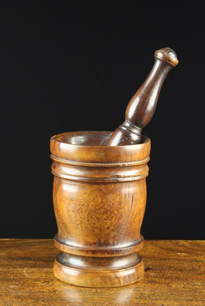 Lot 43 - A Good Late 17th/Early 18th Century Lignum Vitae Pestle & Mortar with turned foot,