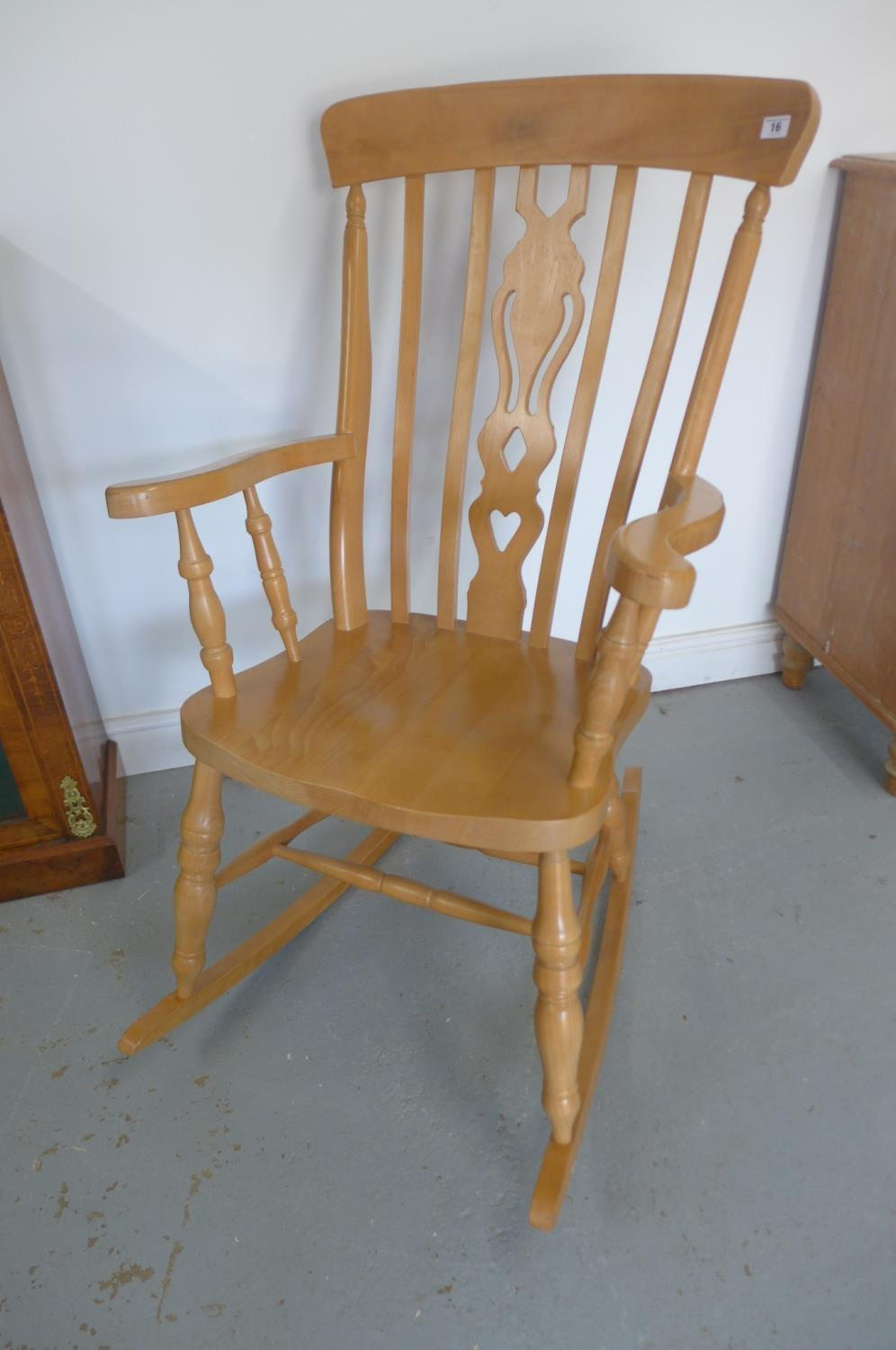 Lot 39 - A modern Victorian style beech rocking chair, in good polished condition
