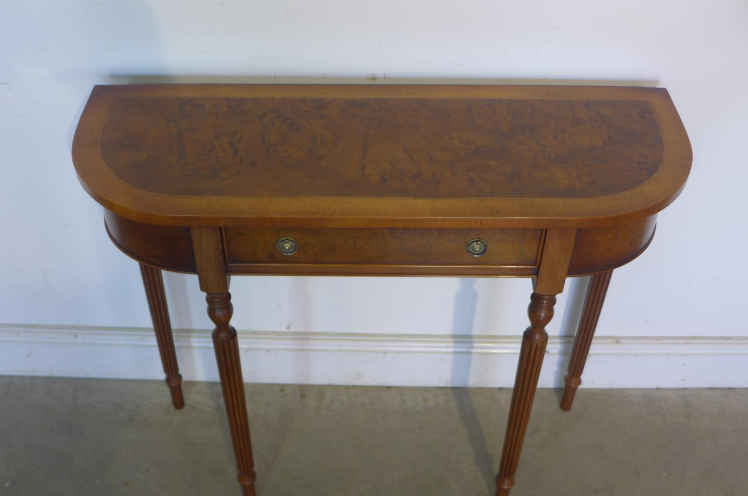 Lot 40 - A walnut D shaped hall table with a single drawer on turned legs, made by a local craftsman to a