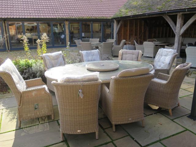 Lot 32 - A Bramblecrest Oakridge dining set - 250cm elliptical table, lazy Susan, six high back dining