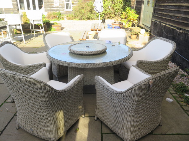 Lot 30 - A Bramblecrest Monte Carlo dining set, 140cm round table, lazy Susan, six armchairs and 3metre