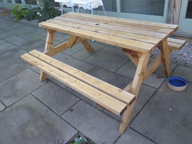 Lot 48 - A timber picnic bench