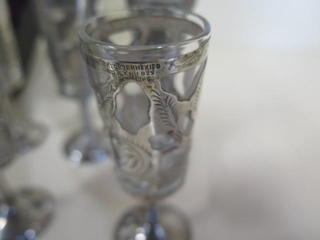 Lot 531 - Five silver cased liqueur glasses, a silver egg cup, a silver fork and spoon and two silver salts,