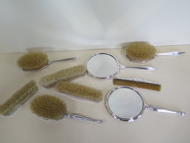 Lot 541 - A silver and enamel five piece dressing table set, hallmarked Birmingham, chip to one piece, and a