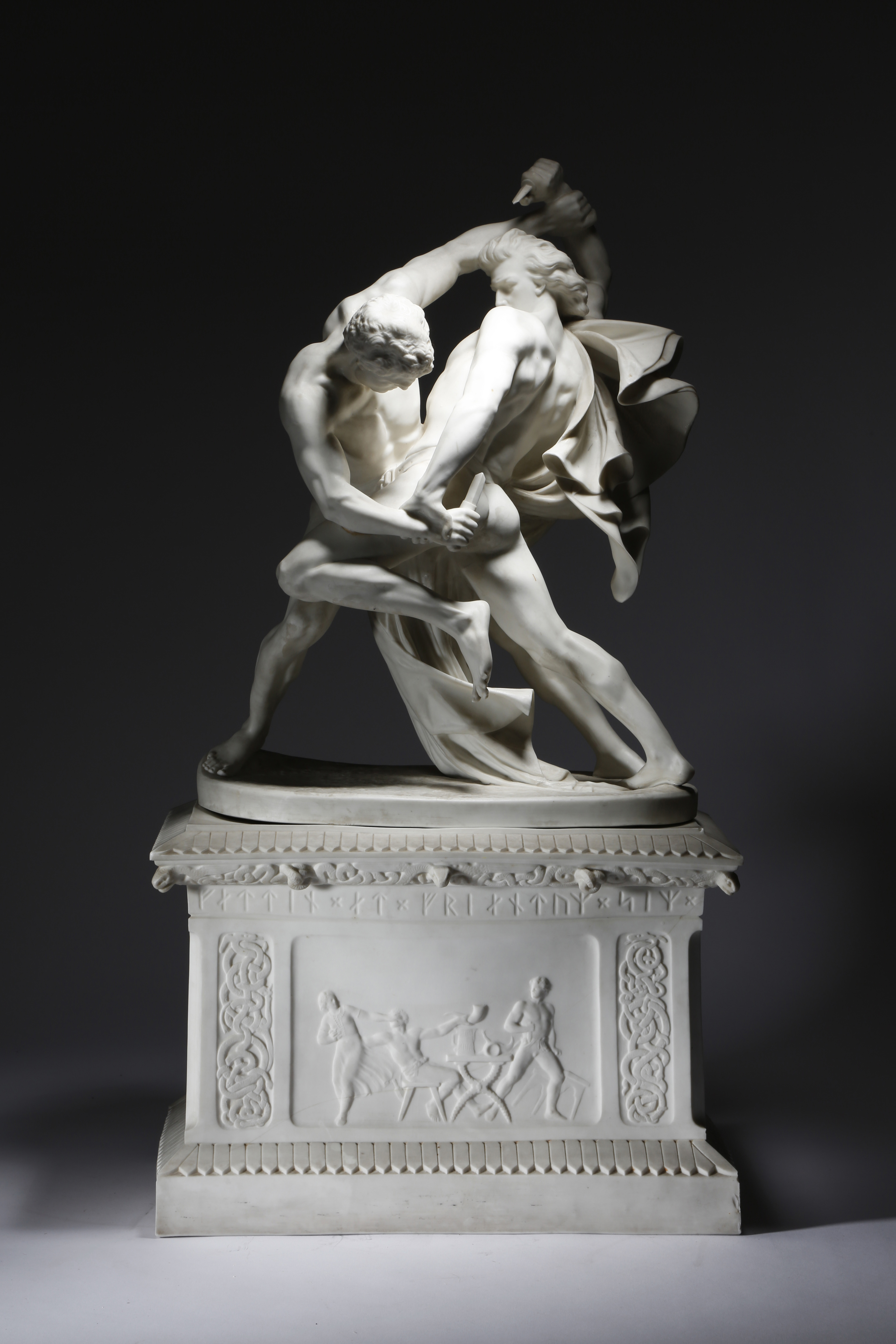 Lot 446 - Johan Peter Molin (Swedish 1814-1873). A biscuit porcelain group of the 'Knife wrestlers' or '