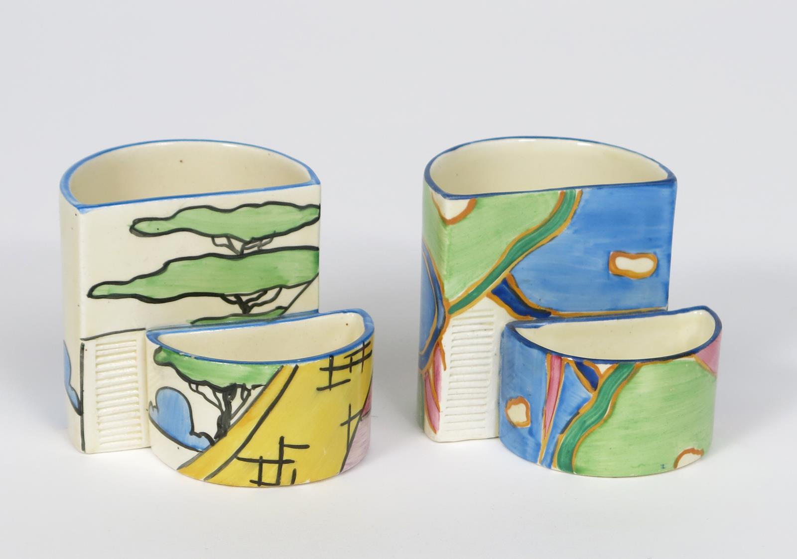 'Pink Roof Cottage' a Clarice Cliff Fantasque Bizarre 463 Cigarette and match holder, painted in
