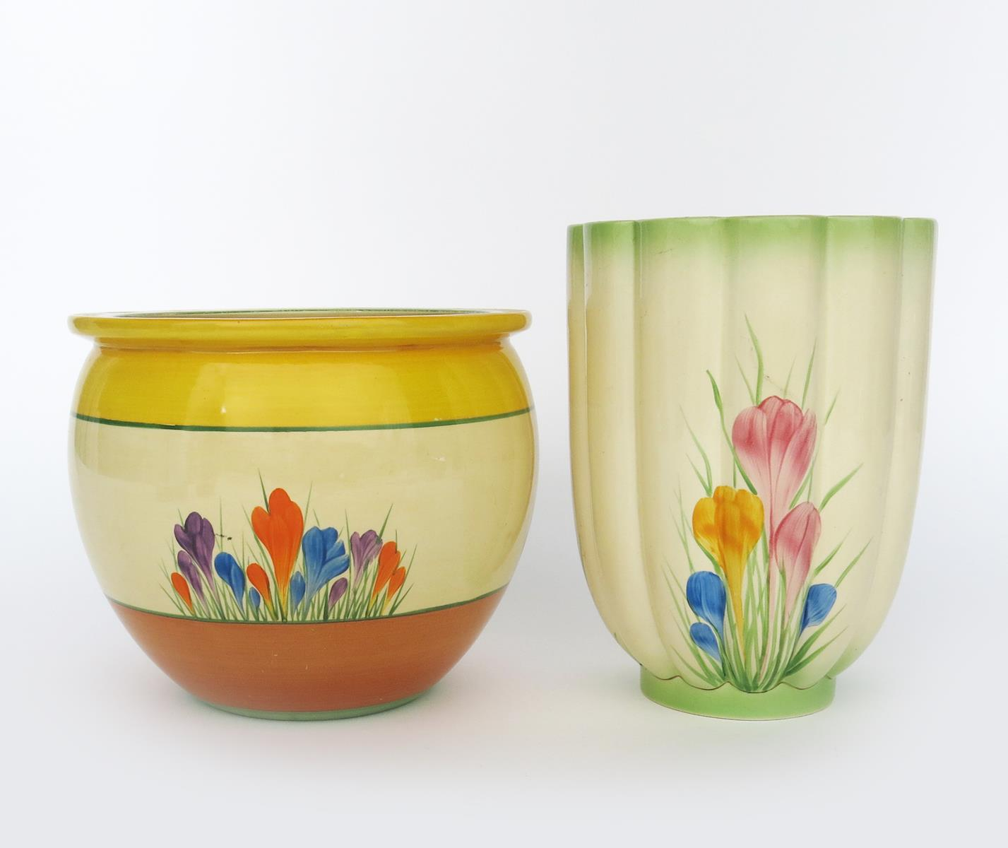 'Crocus' a Clarice Cliff jardiniere, painted in colours between yellow and brown bands, and a
