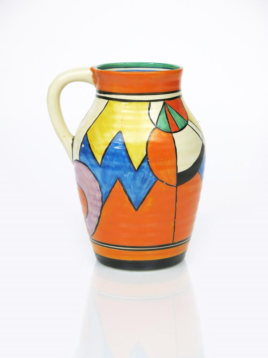 'Blue W' a Clarice Cliff Bizarre single-handled Isis vase, painted in colours between orange and