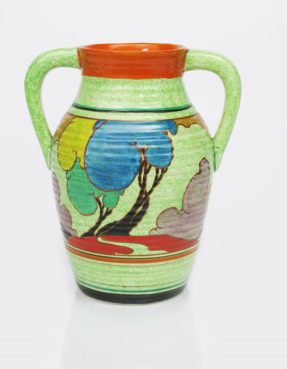 'Cafe au Lait Autumn' a rare Clarice Cliff Bizarre twin-handled Lotus jug, painted in colours on a