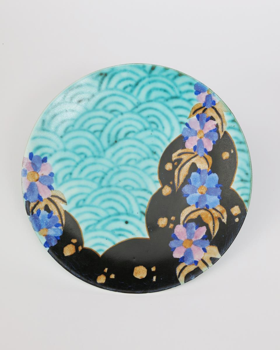 'Inspiration Clouvre' a Clarice Cliff Bizarre wall plaque, painted in colours on a turquoise ground,