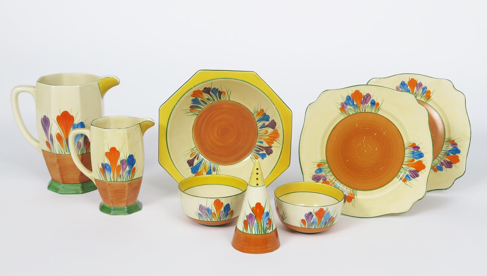 'Crocus' a Clarice Cliff Bizarre Conical sugar sifter, painted in colours between yellow and brown