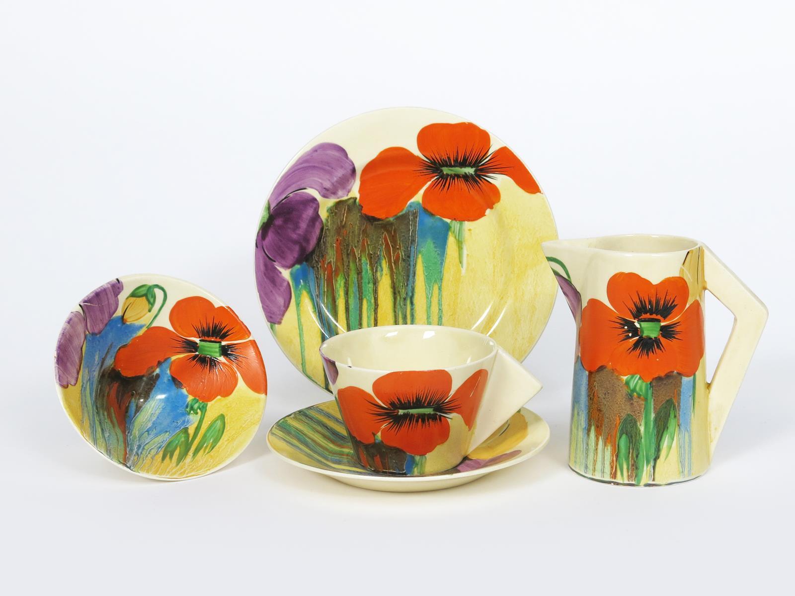 'Delecia Nasturtium' a Clarice Cliff Bizarre part Conical tea set, painted in colours, comprising,