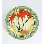 'Honolulu' a Clarice Cliff Bizarre wall plaque, painted in colours inside black and green bands