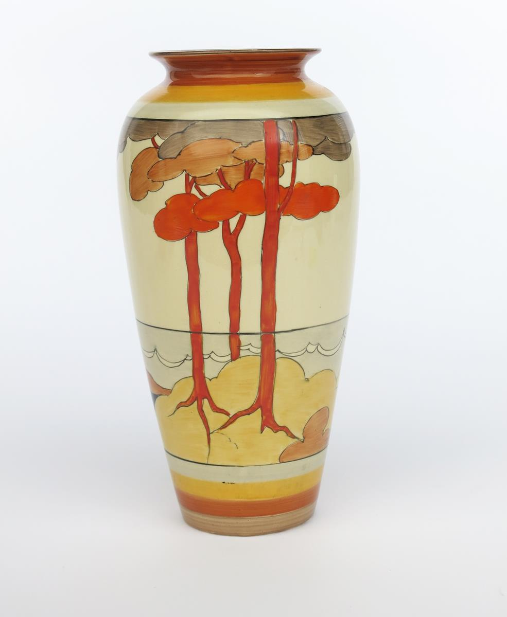 'Coral Firs' a Clarice Cliff Bizarre 120 vase, painted in colours between yellow and brown bands,