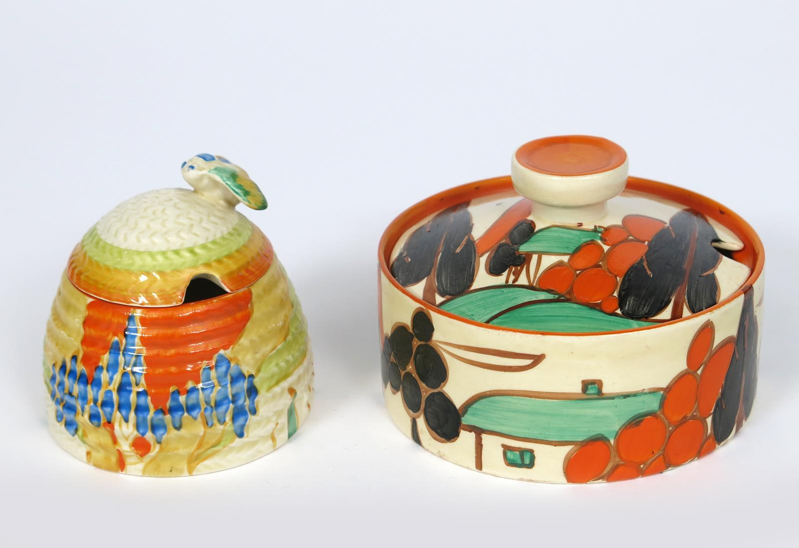 'Windbells' a Clarice Cliff Bizarre beehive honey pot and cover, painted in colours, and a Clarice