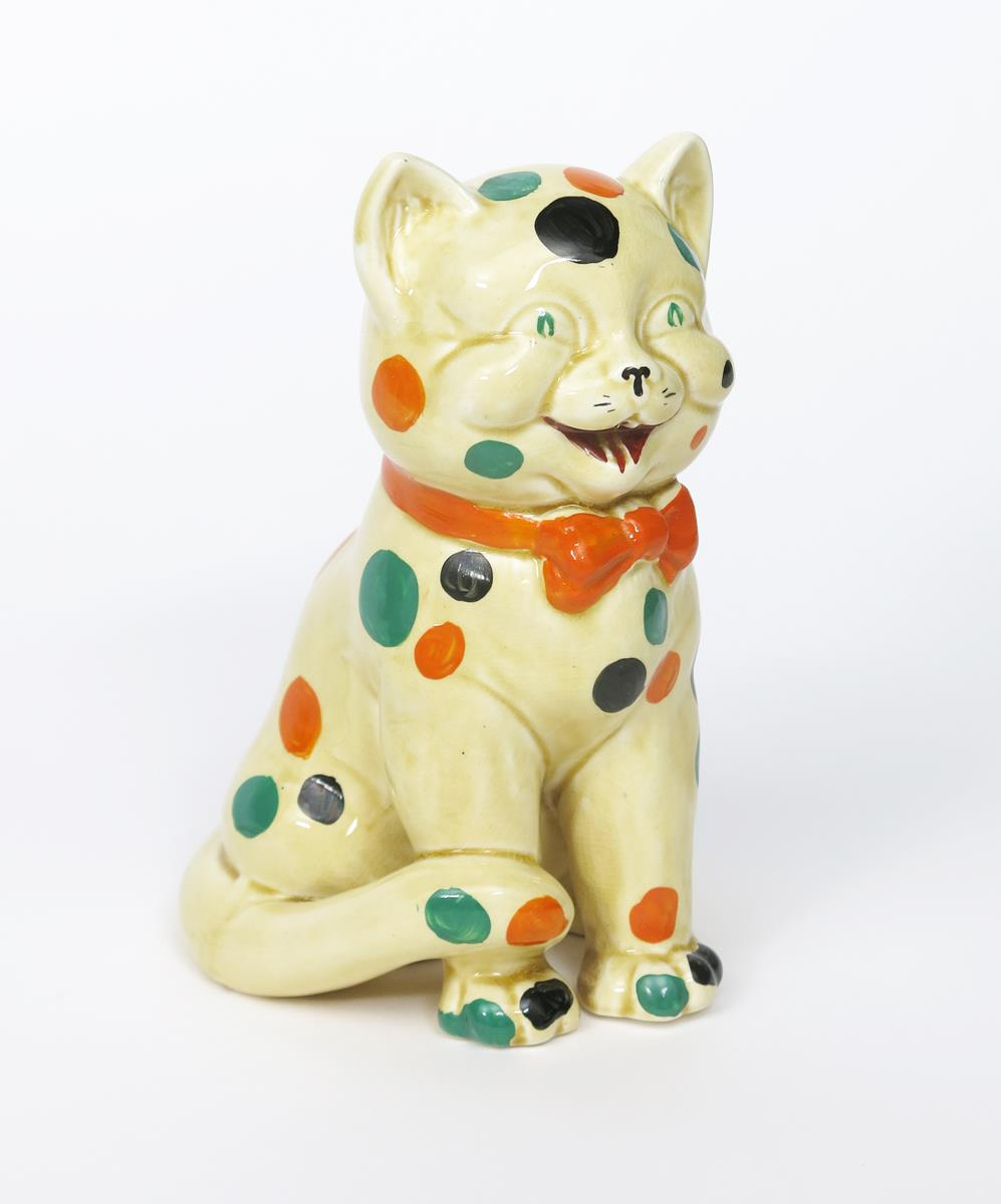 'Laughing Cat' a Clarice Cliff Bizarre figure, modelled seated and wearing a bow tie, painted with - Image 2 of 2