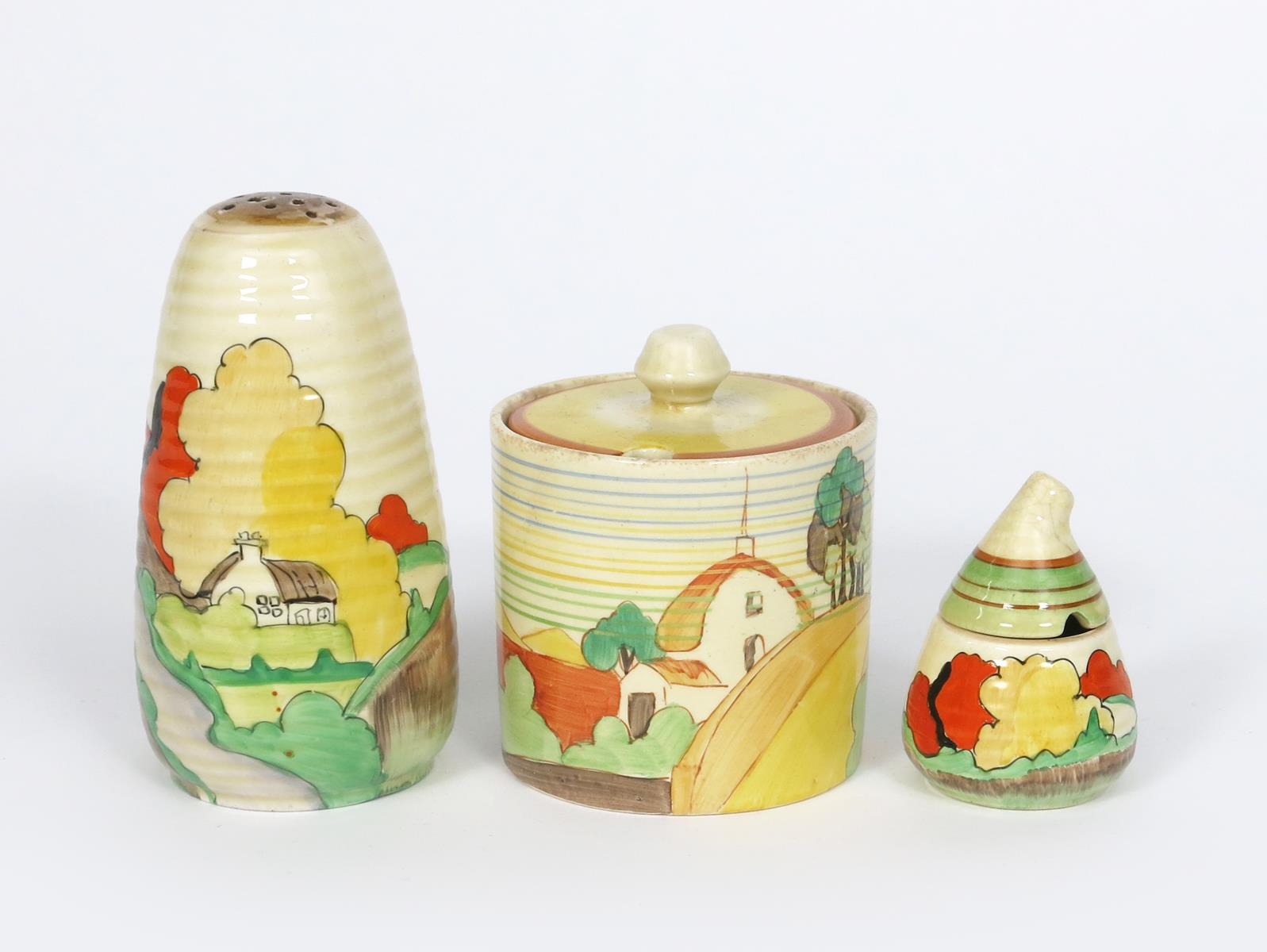 'Brookfields' a Clarice Cliff Lynton sugar sifter, painted in colours, and a Brookfields Cylindrical