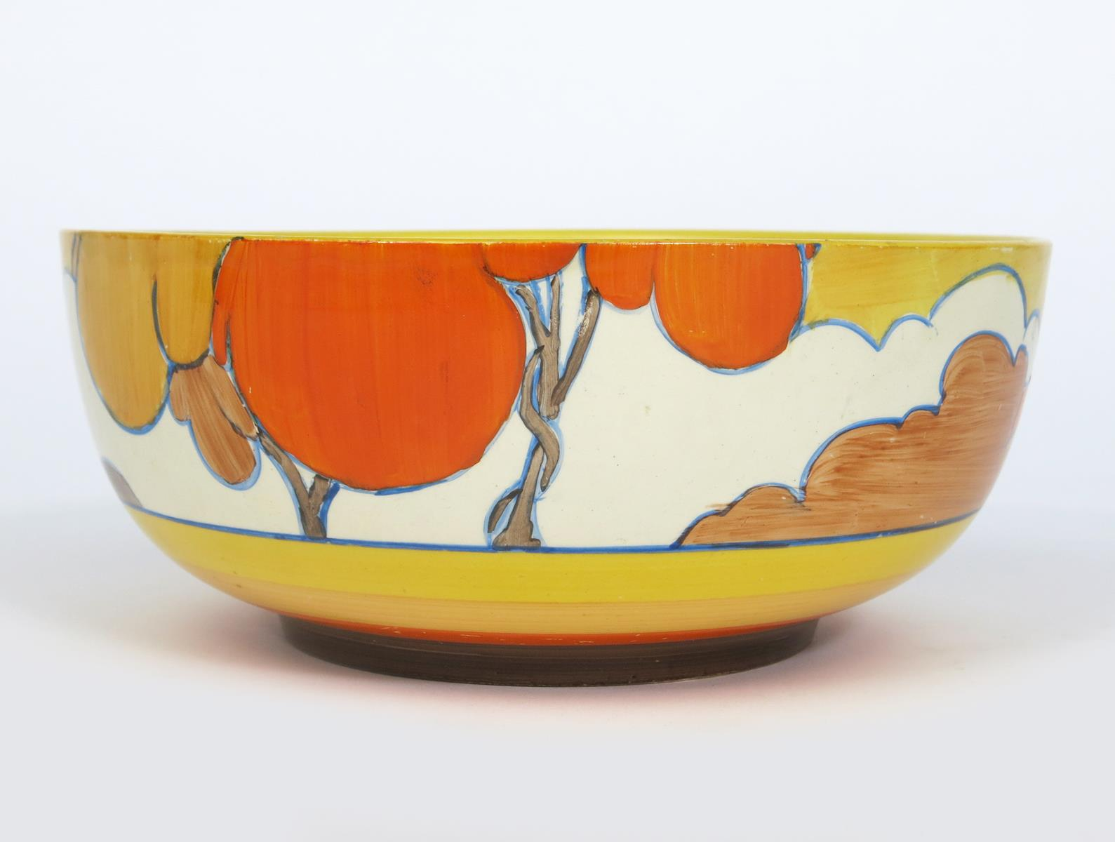 'Orange Autumn' a Clarice Cliff Bizarre bowl, painted in colours, between yellow, orange and brown
