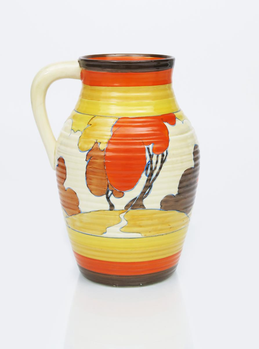 'Autumn' a Clarice Cliff Fantasque Bizarre single-handled Lotus jug, painted in colours between