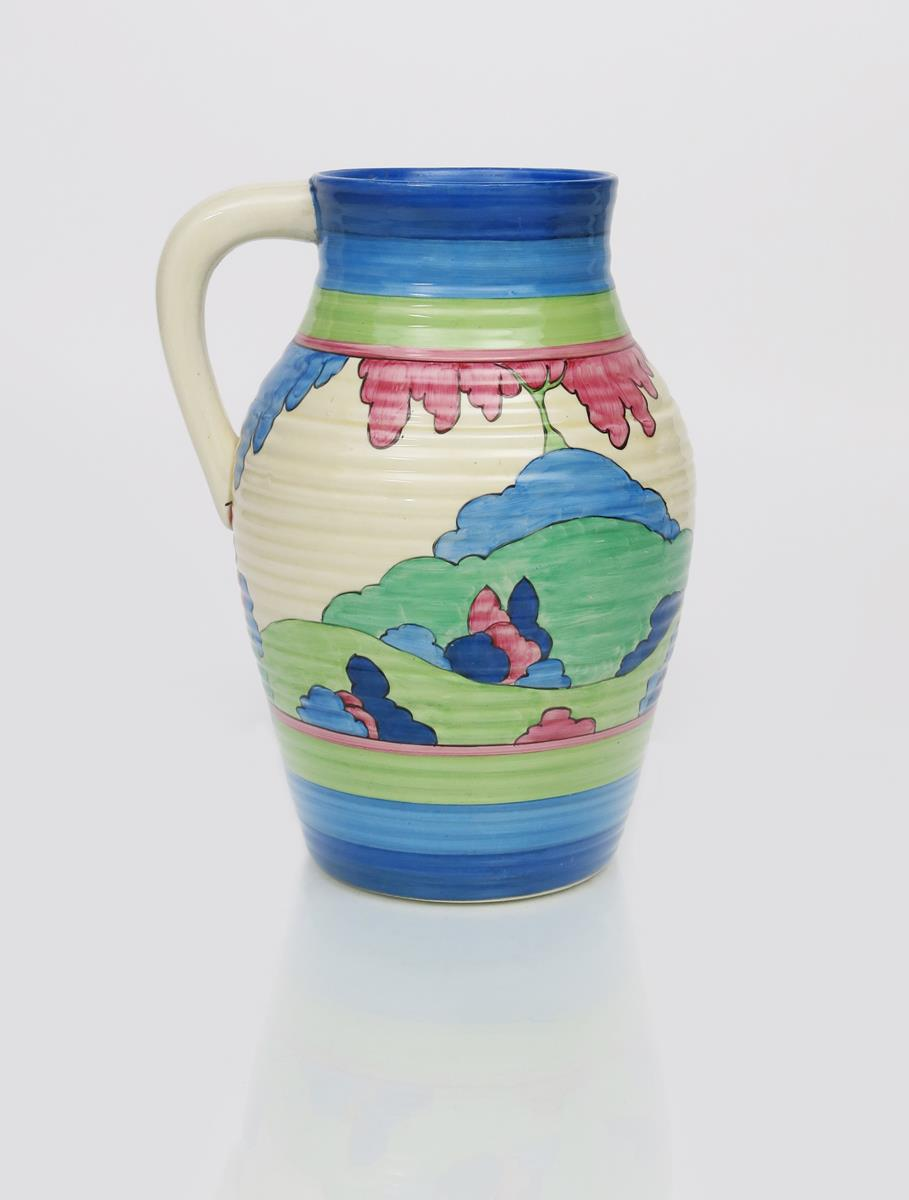 'Rudyard' a Clarice Cliff Bizarre single-handled Lotus jug, painted in colours between blue and - Image 2 of 2