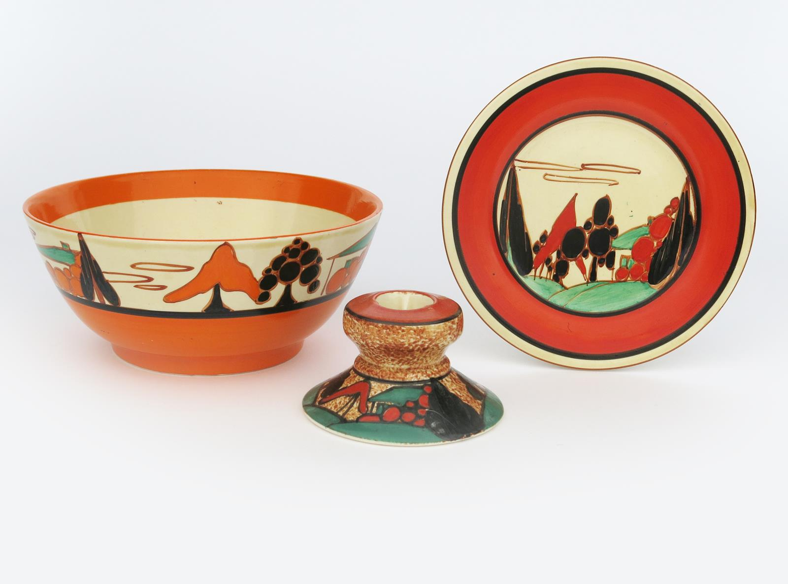 'Red Trees and House' a Clarice Cliff Fantasque Bizarre side plate, painted in colours inside red