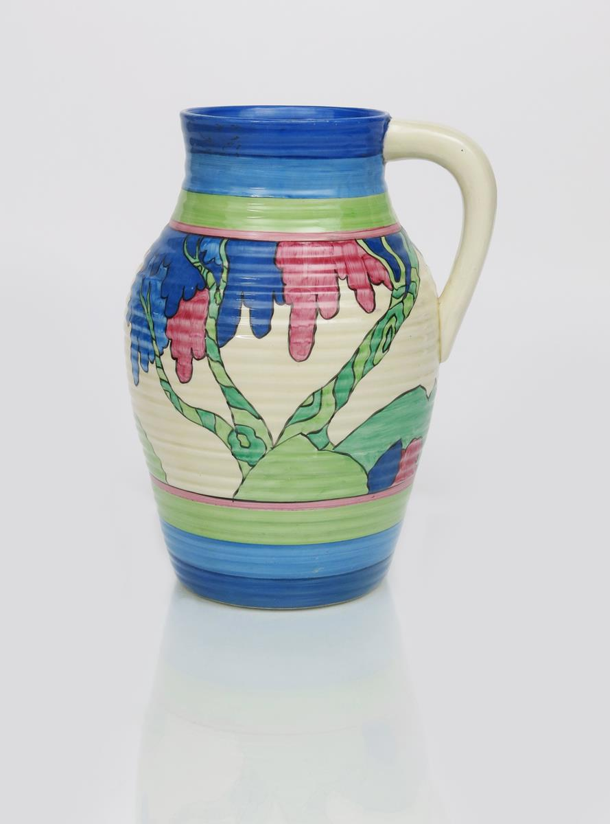 'Rudyard' a Clarice Cliff Bizarre single-handled Lotus jug, painted in colours between blue and