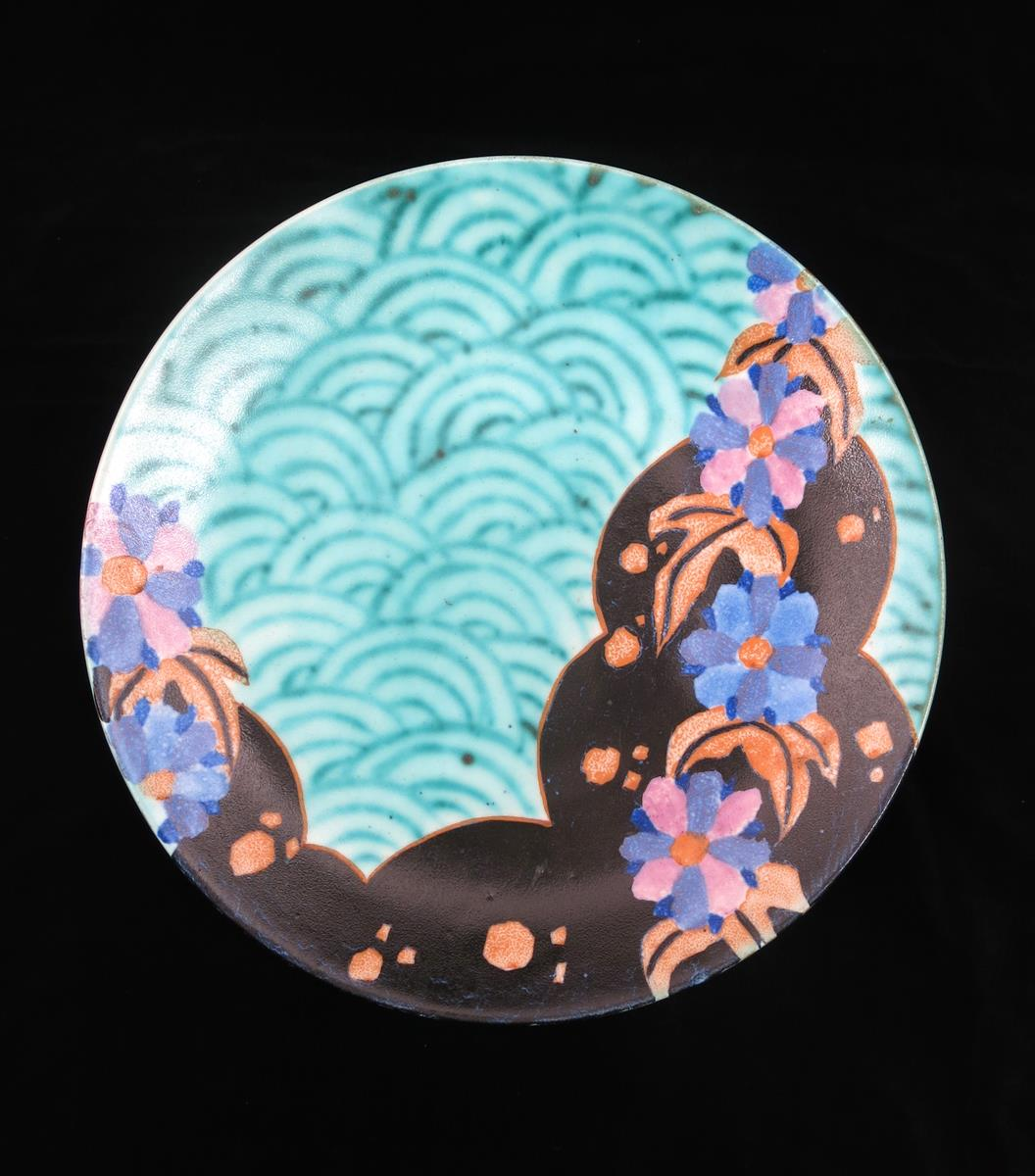 'Inspiration Clouvre' a Clarice Cliff Bizarre wall plaque, painted in colours on a turquoise ground, - Image 2 of 2