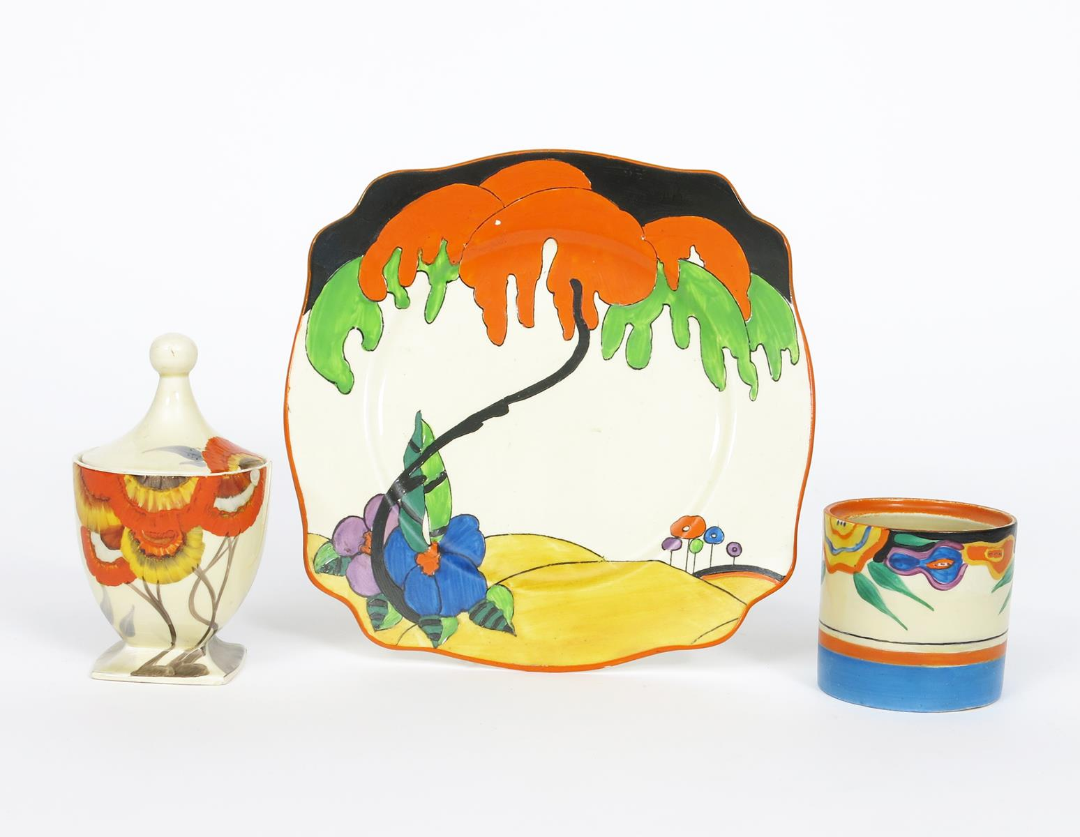 'Woodland' a Clarice Cliff plate, printed and painted in colours, a Clarice Cliff Rhodanthe preserve