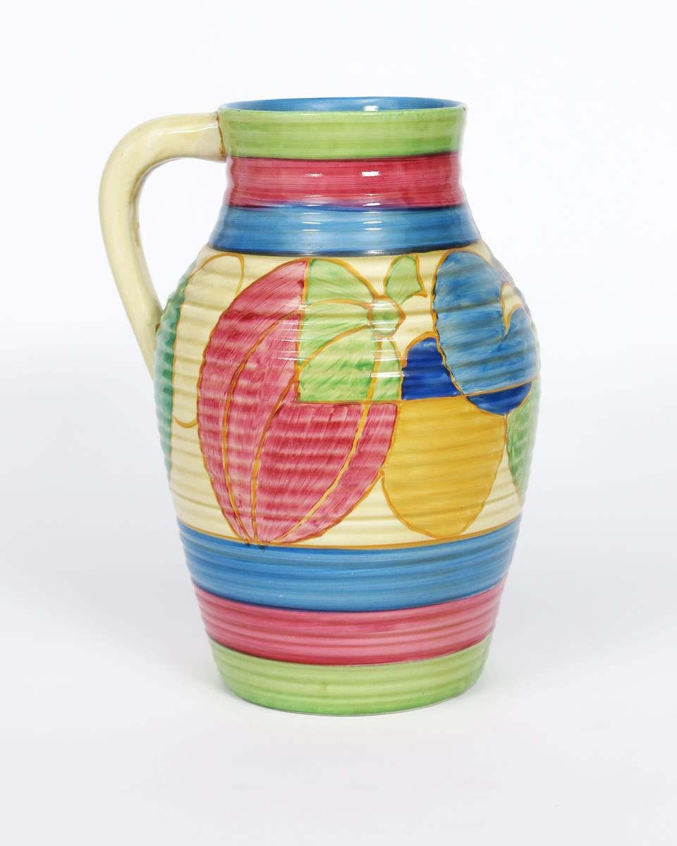'Pastel Melon' a Clarice Cliff Fantasque Bizarre single-handled Lotus jug, painted in colours