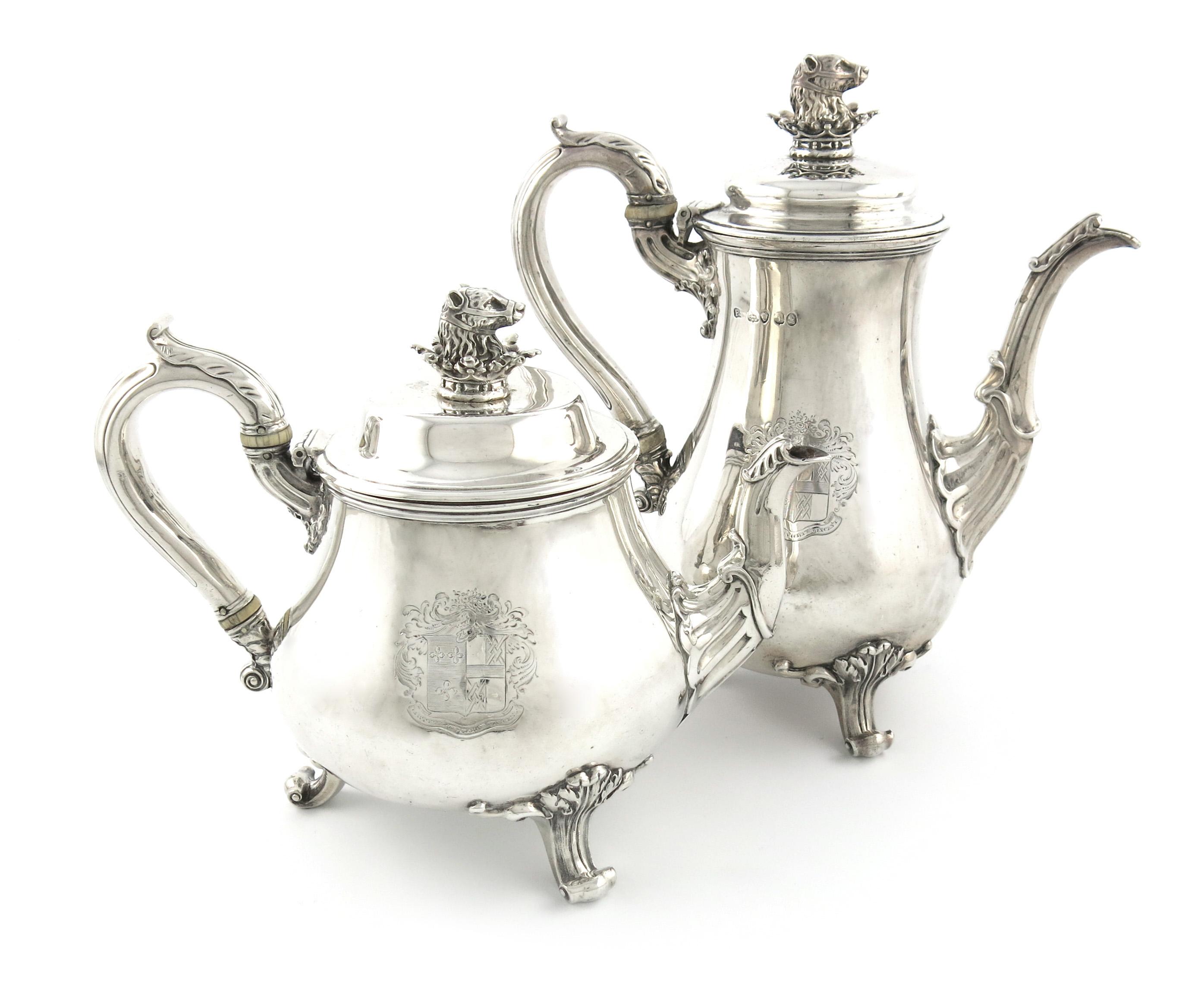 λA George IV silver coffee pot and teapot, by Paul Storr, London 1826, baluster form, leaf capped