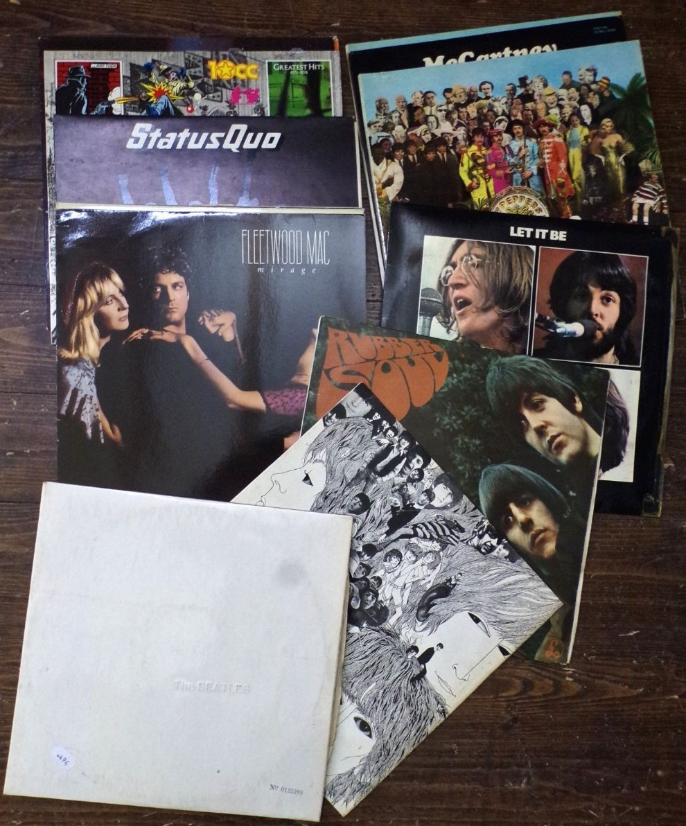 Lot 718 - A quantity of vinyl LPs including The White Album, Revolver and Rubber Soul all by the Beatles,