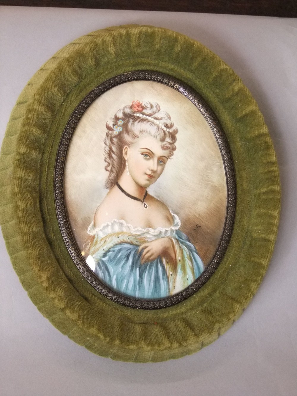 Lot 566 - An oval miniature portrait showing a lady in late 18th century style costume, indistinctly signed,