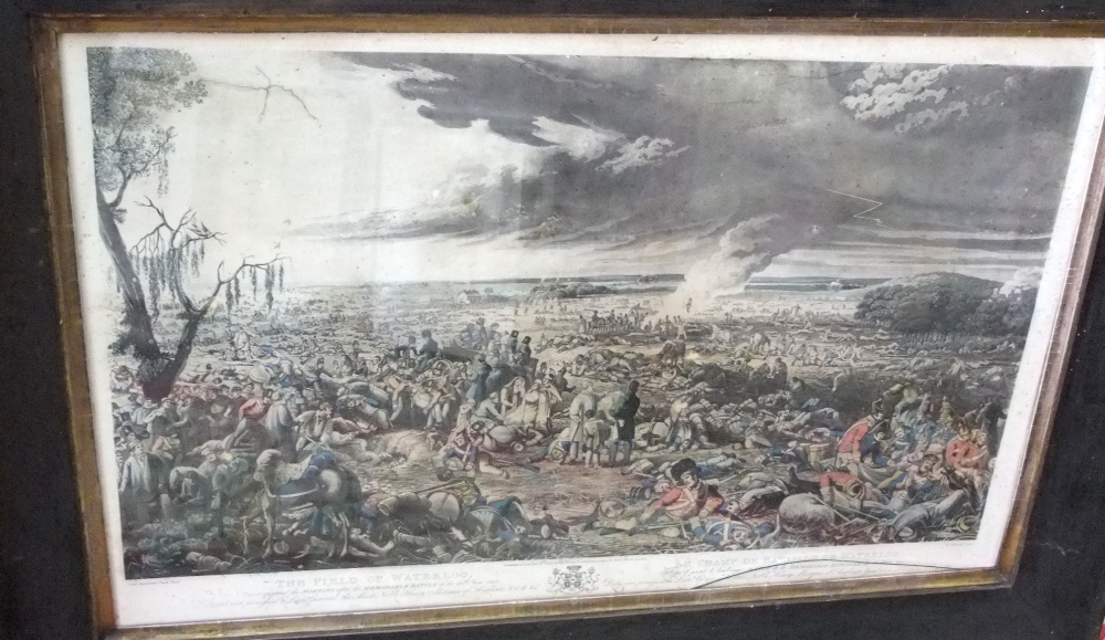 Lot 564 - A collection of pictures and prints including 19th century engraving of The Battle of Waterloo after
