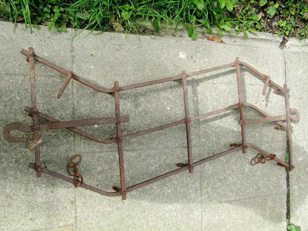 Lot 1009 - An old iron work harrow