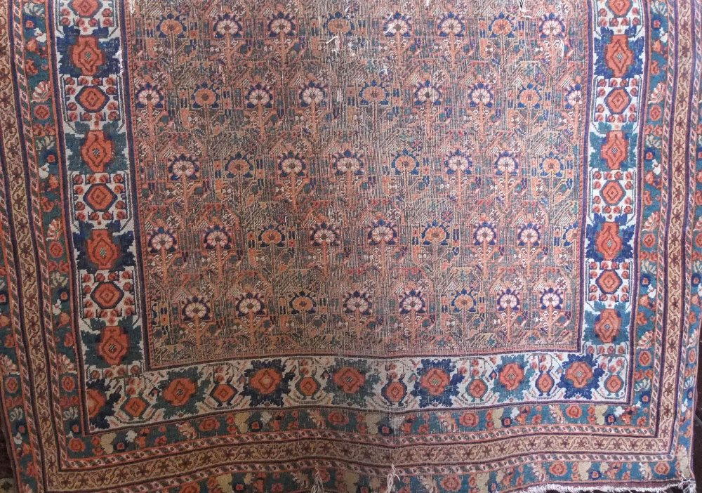 Lot 638 - Antique Persian rug with geometric floral decoration upon a burnt orange ground, 160 x 130cm