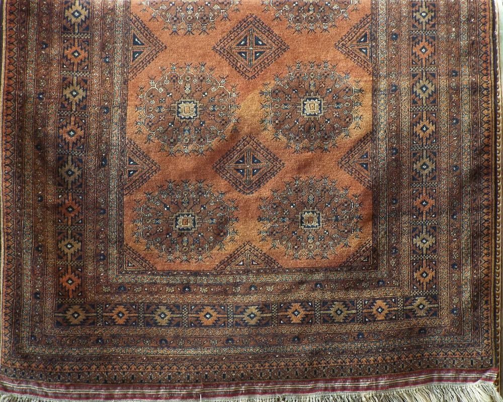 Lot 622 - Good quality Persian carpet with geometric central floral medallion upon an orange ground, 250 x 160
