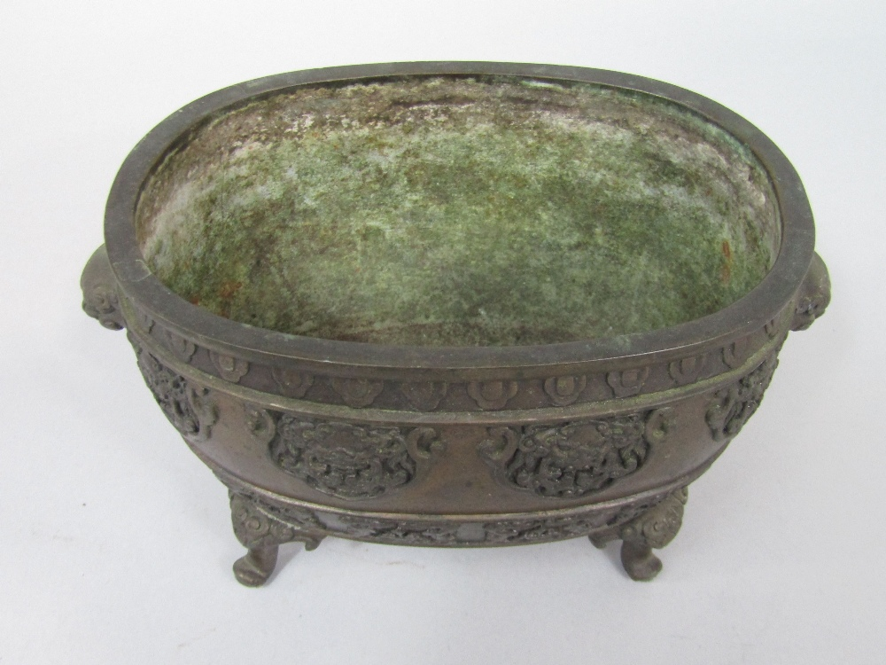Lot 535 - Meiji period Japanese bronze censer of oval form, with a band of shaped relief work panels of
