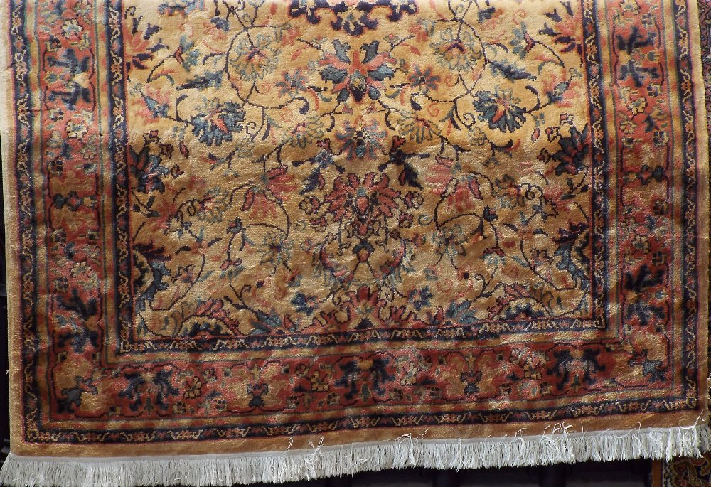 Lot 612 - Keshan type full pile carpet with central blue floral medallion framed by further scrolled foliage