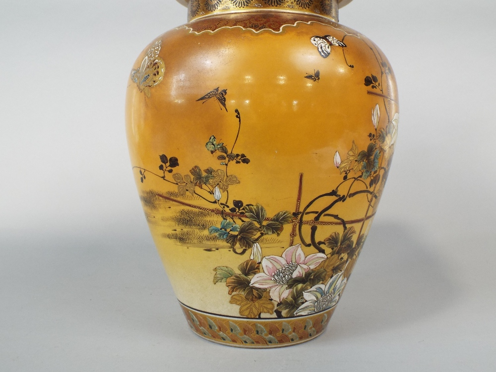 Lot 55 - A substantial late 19th century Satsuma type vase and cover with polychrome painted floral and