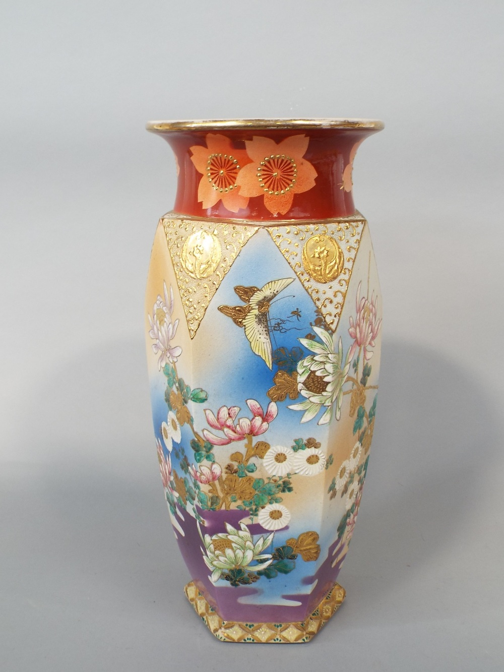 Lot 51 - A large early 20th century satsuma vase of hexagonal form with painted and gilded floral detail,