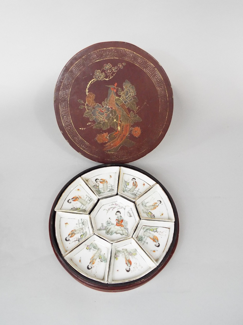 Lot 57 - An early 20th century oriental supper set comprising eight shaped dishes around a central