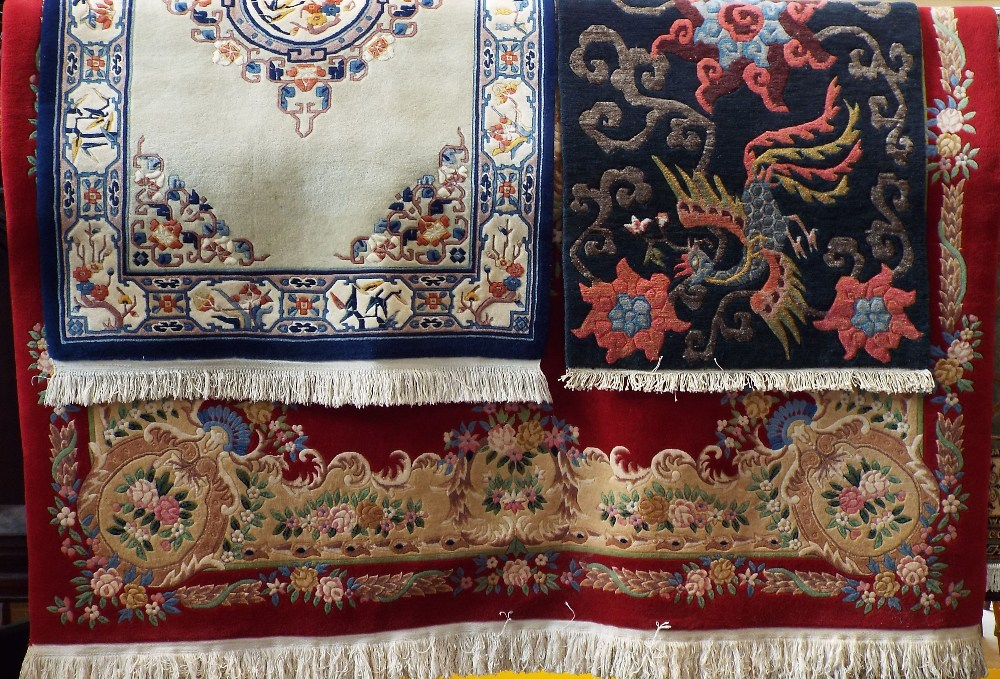 Lot 623 - Large Chinese full pile wool carpet with typical pastel decoration upon a red ground 360 x 250 cm;