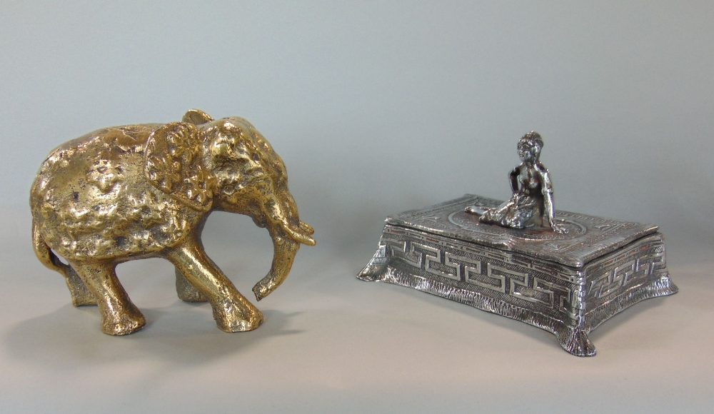 Lot 507 - Art nouveau cast white metal cigarette box, the lid with cast figure of a reclining female on a rug,