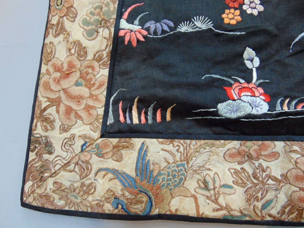 Lot 428 - Late 19th/ early 20th century Chinese robe with black silk ground extensively embroidered with