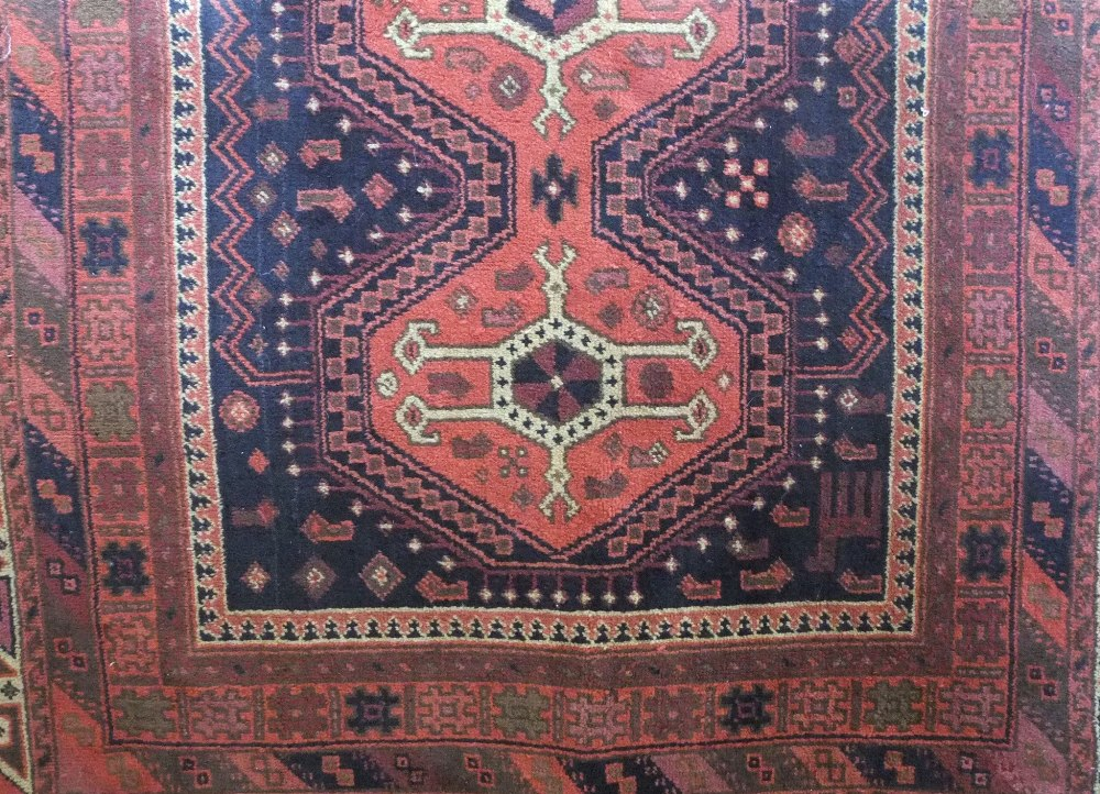 Lot 628 - Cashmere full pile rug decorated with a central medallion upon a burnt orange ground, 200 x 140cm