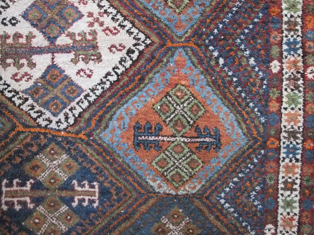 Lot 634 - Turkish full pile rug with geometric medallions upon a blue ground, 200 x 145cm